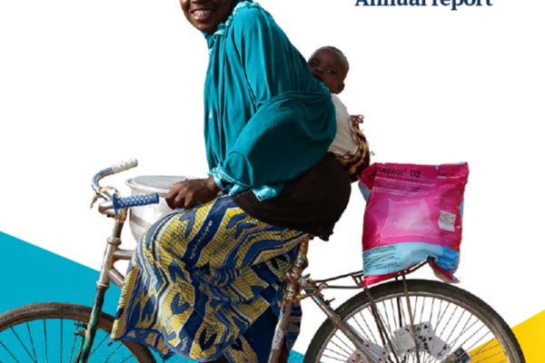 Front cover of the annual report showing a lady on a bike