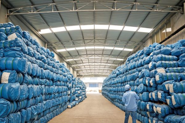 A warehouse full of mosquito nets showing volume guarantees in action
